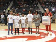 Atlanta Hawks Community and Chief Diversity & Inclusion Officer Nzinga Shaw presents Atlanta Music Project (AMP) participants and Co-Director Aisha Moody with three of the 15 drums the team donated to AMP on April 24.