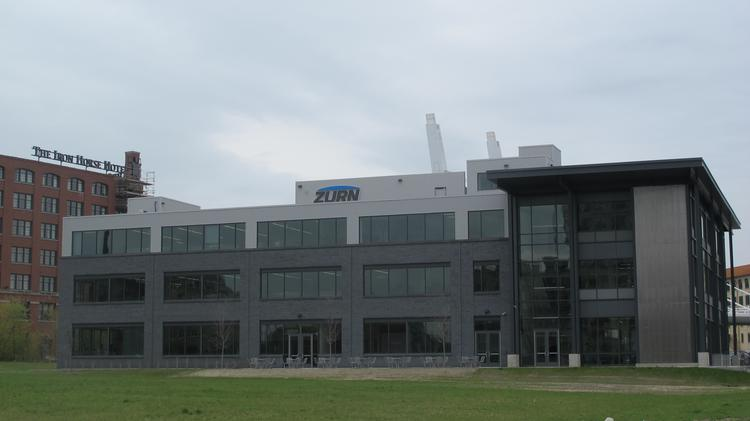 Rexnord purchases Zurn HQ building in Reed Street Yards