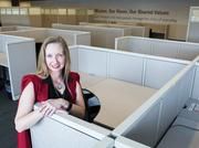 State Farm recruiter DeAnne Prigmore is just one of the recruiters looking to hire people to fill empty cubicles in Building 5 on their Tempe campus. Darryl Webb/for Phoenix Business Journal.