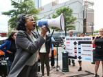 Protesters gather at Duke Energy HQ during first online-only shareholder meeting