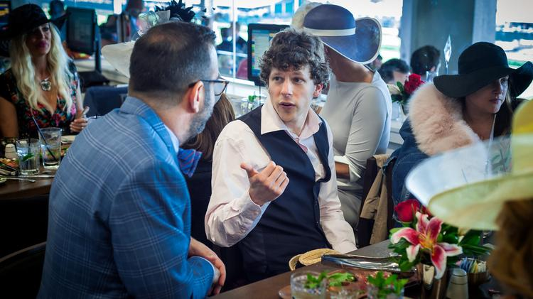Actor Jesse Eisenberg talks in the Turf Club.