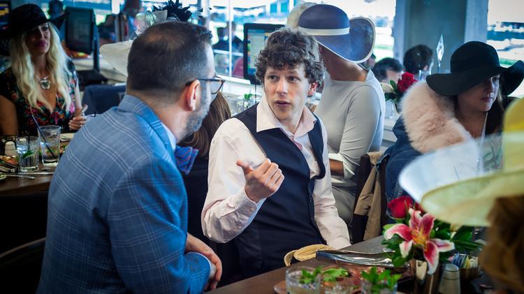 Actor Jesse Eisenberg talks in the Turf Club.
