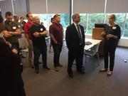 Flanked on May 9 by a group of architects, designers and land-use professionals, Mayor Steve Adler, second from right, listens as Michele Van Hyfte, far right, explains the results of her team's efforts to simulate allowable high-rise development under CodeNEXT.