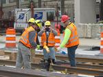 Streetcar's first track lengths settle into place in downtown Milwaukee