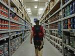 'Exosuit' developed at Va. Tech brings superpower-like skills to Lowe's employees