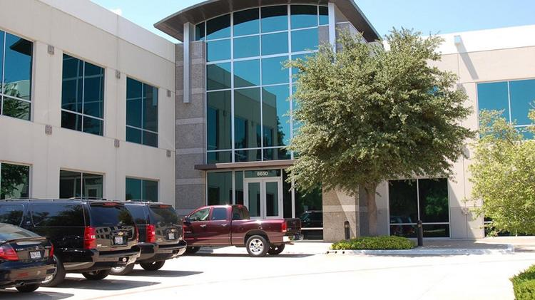 Sirius XM is expanding in this two-story office building in Irving.