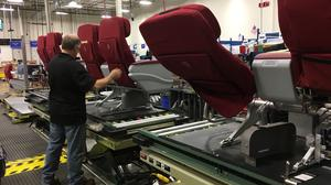 Why Rockwell Collins pays Triad residents $100 per day to sit in airplane seats