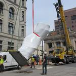 Massive sculpture lifted into place on downtown Milwaukee's Wisconsin Avenue