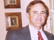 A historical photo captures founder Steven D. Bell in the early days of starting the real estate company.