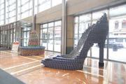 The team from MSA Architects sculpted a high-heeled shoe of blue-labeled cans. In the background, at left, is the sombrero created by FRCH Design. The sculptures, along with others, can be seen at the Aronoff Center for the Arts. The sculptures will remain on display through March 10. Winners will be chosen in a number of categories. The winners will be announced at the annual awards gala Feb. 22.