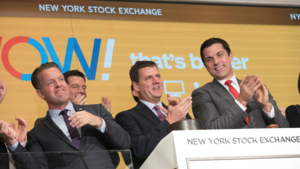 WOW Cable CEO Steve Cochran, center, celebrates the Denver-based company's IPO with other officials at the New York Stock Exchange on Thursday, May 25, 2017.