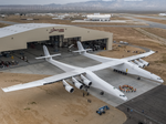 Paul Allen rolls his massive Stratolaunch satellite launcher out from the hangar for the first time (Photos)