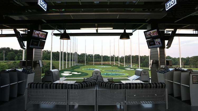 The first phase of an entertainment district in University City includes a Topgolf facility — Charlotte's second — at 7199 MacFarland Blvd., that will open this summer. This file photo shows the first Topgolf location to open in Charlotte.