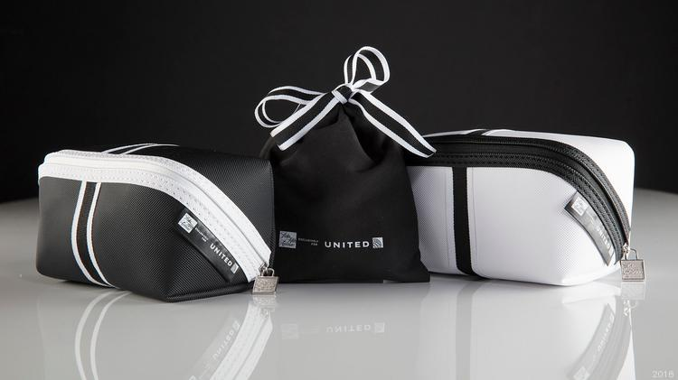 New United Airlines amenity kits include (left to right) a Polaris international  business class 8d068bafa0523
