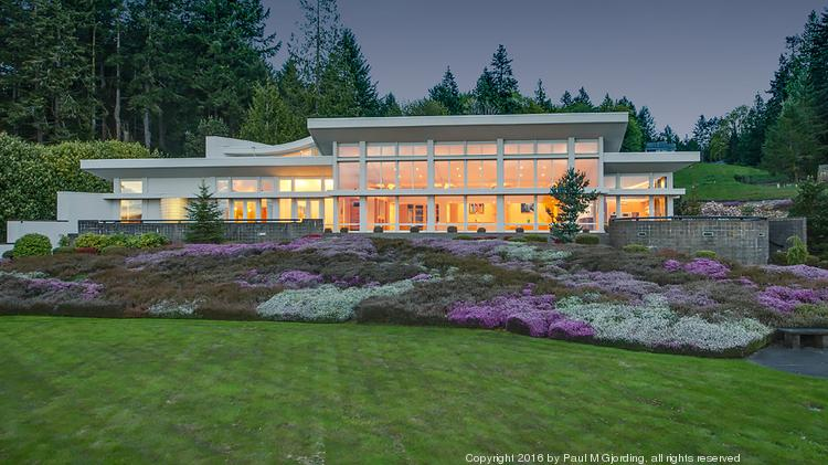 A stunning estate of grand scale, comprised of clean lines, and walls of windows effectively bringing the outside in. This custom-built Northwest contemporary manse offers unparalleled privacy on 5.56 gated and fenced acres of lush manicured grounds, with 300-feet of no-bank Hood Canal waterfront.