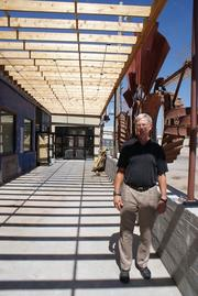 Dave Burk stands inside a new patio space created on the east side of the former Doc Howard's building. Taste and See and another tenant will share the space.