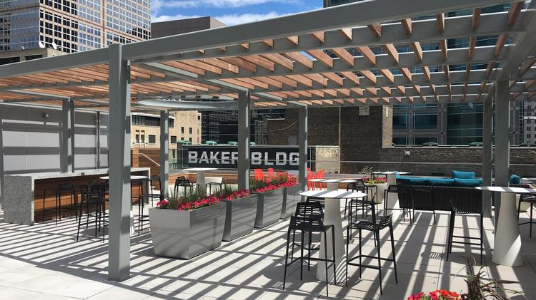 The Rooftop Patio At Baker Center, Which Has A Bar, Pergola And Views Of
