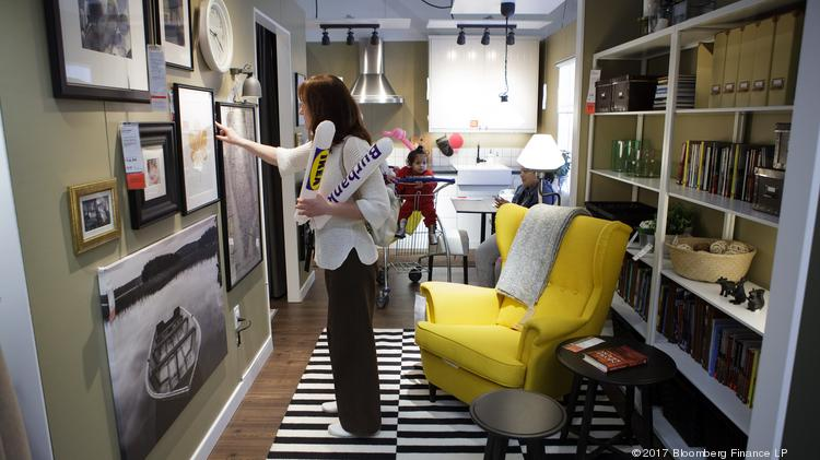 A Shopper Looks At Decorative Art At An Ikea Store In Burbank. Apple Has  Partnered