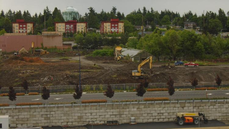 Crews have begun building two large buildings in Des Moines, south of  Seattle-Tacoma