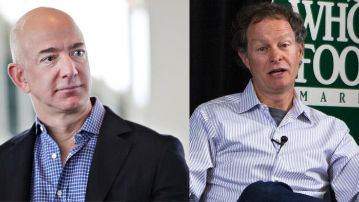 Jeff Bezos of Amazon.com Inc., left, and John Mackey of Whole Foods Market Inc.