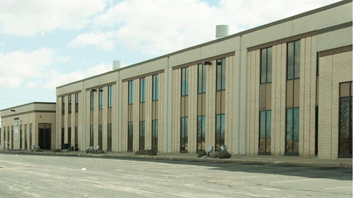 Heating and cooling gear distributor buys New Berlin building