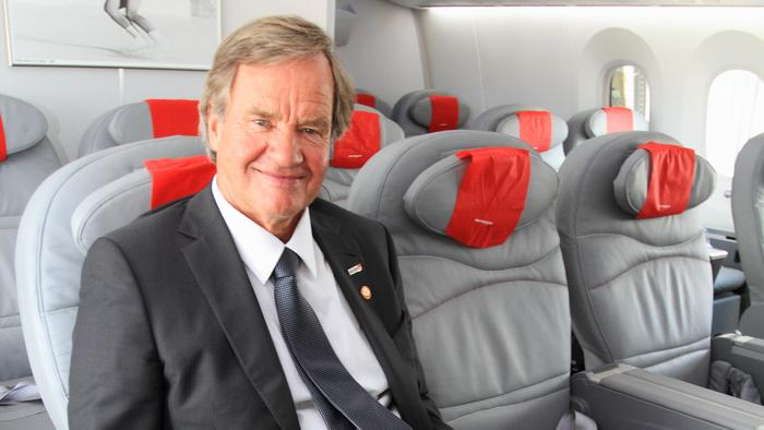Norwegian Air CEO Bjorn Kjos enjoys a seat in one of his airlines's 787 Dreamliner's first class section. The ultra low-cost carrier brings its service to Seattle this fall.