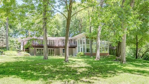 Ranch Style Home on 3+ Privately Wooded Acres in Wayzata Schools