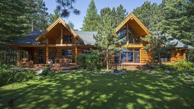 Dream cabins custom built log cabin on big trout lake on for Big log houses