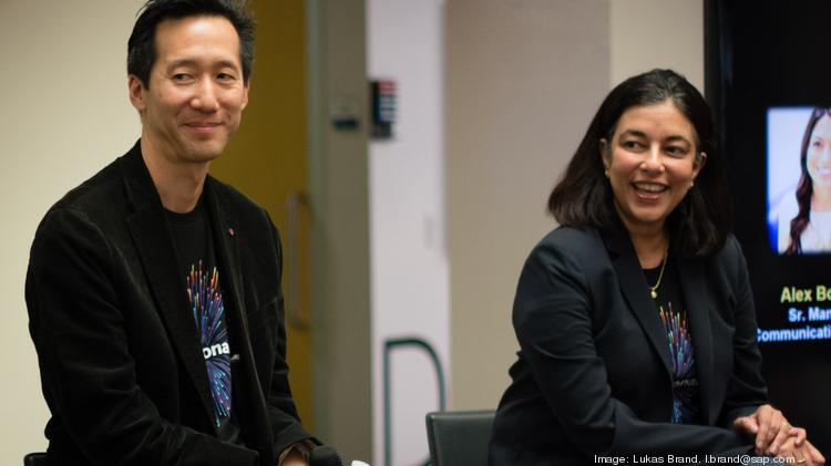 Sam Yen, managing director for SAP Silicon Valley sits alongside Leonardo President Mala Anand on Wednesday afternoon as hundreds of employees listen to them speak on SAP's latest technology offerings.