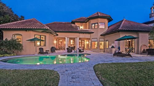 Tuscan style waterfront home custom built for luxury