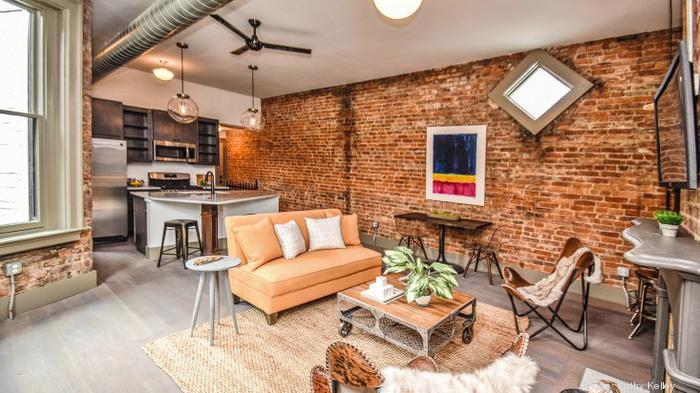 This is the larger, 800-square-foot model condo at Vivian Lofts. The diamond shaped windows are original to the building.