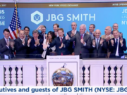 JBG Smith Properties CEO Matt Kelly, center, accompanied by company executives and guests, including Mitchell Schear, second from the right in the front row, who served as president of Vornado Realty Trust's D.C. division prior to its spin-merge with The JBG Cos. to form the new publicly traded company.