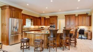 Exceptional home in coveted Innisbrook Estates offers 7 bedrooms & 4 1/2 baths