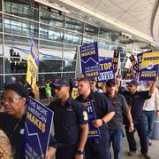 Unions representing aircraft maintenance, fleet service, facilities and ground support employees picketed at DFW Airport for new contracts and for an end to outsourcing.