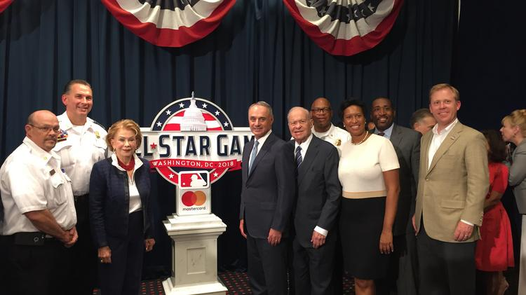 D.C. Mayor Muriel Bowser helps unveil the logo for the 2018 MLB All-Star Game.