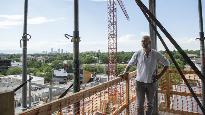 Matt Joblon, CEO of BMC Investments, on the top floor of his firm's apartment project at 255 St. Paul St.