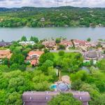 Need a mansion with a Romeo and Juliet balcony? Lake Austin home has that and more, including dramatic backstory