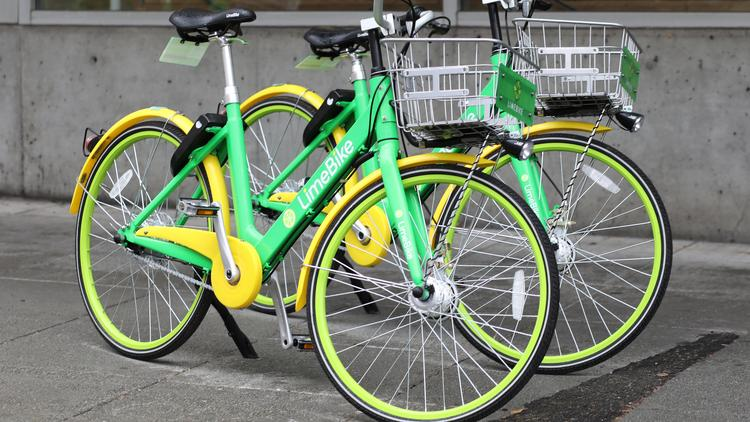 Download an app, grab a bike: Lime's bright green dockless