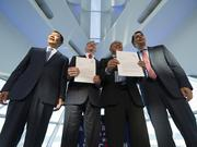 Officials representing Foxconn and the state of Wisconsin showed off the agreement that was signed Thursday at the Milwaukee Art Museum.