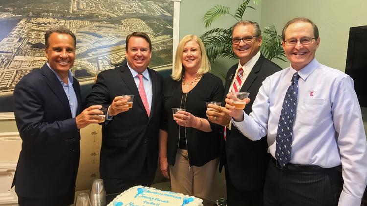 Keyes CEO Mike Pappas, Jim Kirvin of Platinum Properties, Gail Lombard of Bluffs Real Estate, John Kern of Platinum Properties and Keyes Senior Vice President Steve Reibel celebrate the merger.