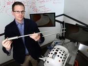 Dr. Jon Thompson demonstrates a prototype of one of his inventions.