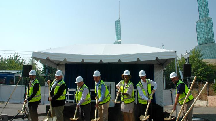 Officials from the city of Portland, including Mayor Ted Wheeler, as well as Metro, Mortenson, Hyatt, the Schlesinger Companies and the Metropolitan Exposition and Recreation Commission and turned the ceremonial first shovels of dirt for the forthcoming Oregon Convention Center Hotel at a celebration Friday morning.