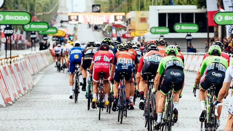 793e92764 Members of Slipstream Sports  Cannondale-Drapac professional cycling team  race in Paris during the