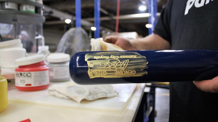 A Worker At Louisville Slugger Museum Factory Puts The Finishing Touches On Customized