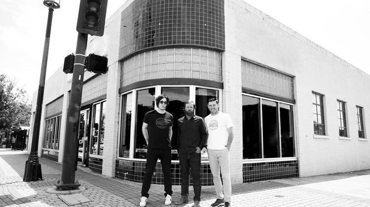Warstic owners (L-R) Jack White, Ben Jenkins and Ian Kinsler stand in front of the company's future headquarters in Dallas' Deep Ellum neighborhood.