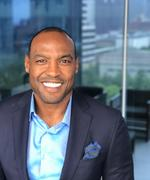 Real estate firm drafts new player with Darren Woodson