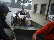 Women rescued from a flooded retirement home sit in a boat after Hurricane Harvey in Spring, Texas, on Aug. 28.