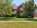 Home of the Day: Spacious 2 story walkout on 2nd hole of Glen Oaks Golf Course--views for days!