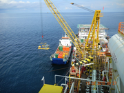 A custom Caterpillar engine driven pump package being loaded on the platform in the South China Sea.