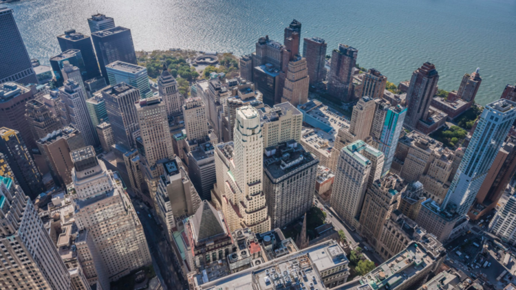 The skyline of the financial district in New York. U.S. bankers have warned about mounting risks in commercial real estate, with figures showing they are putting the brakes on loans to buyers of office buildings, hotels and shopping malls.